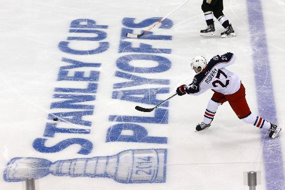 Columbus Blue Jackets' Ryan Murray (27) shoots during the first period of a first-round NHL playoff hockey game against the Pittsburgh Penguins in Pittsburgh on Wednesday, April 16, 2014