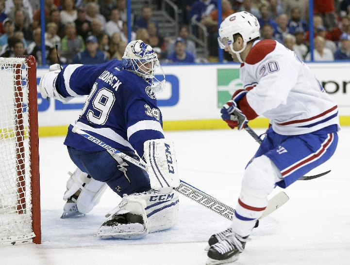 Tampa Bay Lightning goalie Anders Lindback (39), of Sweden, cuts back but cannot stop Montreal Canadiens left wing Thomas Vanek (20), of Austria, from scoring during the third period of Game 1 of a first-round NHL hockey playoff series on Wednesday, April 16, 2014, in Tampa, Fla