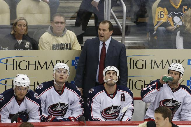 Columbus Blue Jackets coach Todd Richards stands behind his bench in the third period of a first-round NHL playoff hockey game against the Pittsburgh Penguins in Pittsburgh on Wednesday, April 16, 2014. The Penguins won 4-3