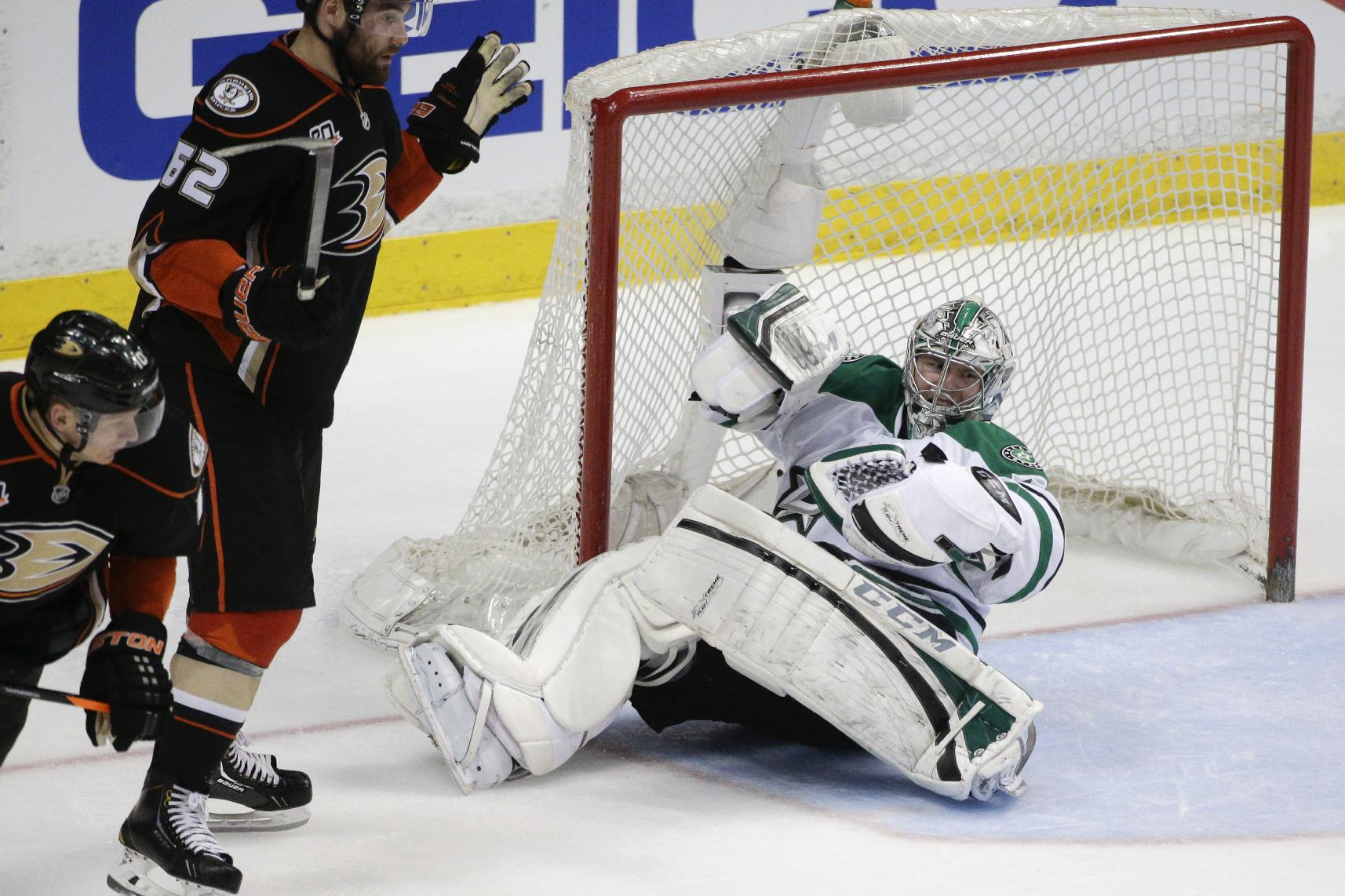 Dallas Stars goalie Kari Lehtonen, center, of Finland, falls to the ice as Anaheim Ducks' Patrick Maroon, left, watches during the second period in Game 1 of the first-round NHL hockey Stanley Cup playoff series on Wednesday, April 16, 2014, in Anaheim, Calif