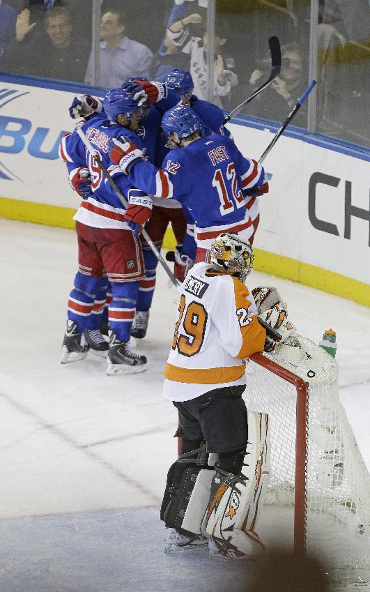 Philadelphia Flyers goalie Ray Emery (29) reacts as the New York Rangers celebrate a goal by Rangers' Carl Hagelin during the third period in Game 1 of an NHL hockey first-round playoff series on Thursday, April 17, 2014, in New York. The Rangers won the game 4-1