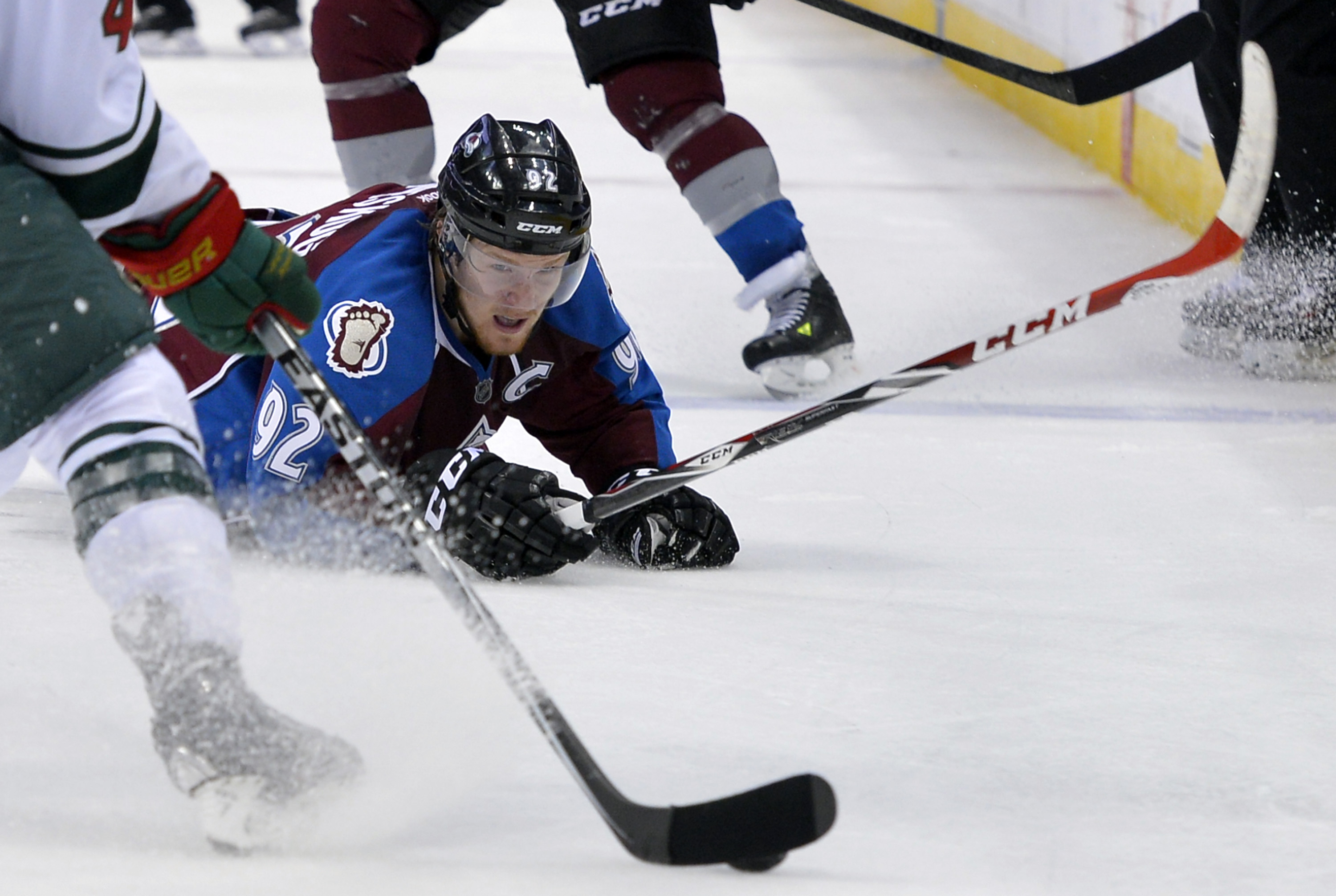 Colorado Avalanche left wing Gabriel Landeskog (92), from Sweden, looks on from the ice during the second period in Game 1 of an NHL hockey first-round playoff series against the Minnesota Wild, Thursday, April 17, 2014, in Denver