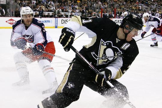 Pittsburgh Penguins' Evgeni Malkin (71) works the puck in the corner against Columbus Blue Jackets' Boone Jenner (38) in the second period of a first-round NHL playoff hockey game in Pittsburgh, Saturday, April 19, 2014