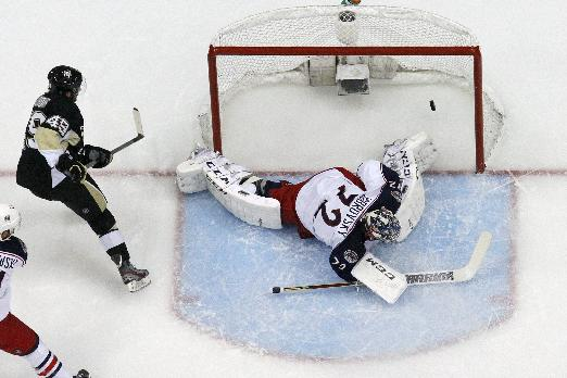 Pittsburgh Penguins' Brian Gibbons (49)  puts his second goal of the first period over Columbus Blue Jackets goalie Sergei Bobrovsky (72) during a first-round NHL playoff hockey game against the Columbus Blue Jackets in Pittsburgh Saturday, April 19, 2014. The Blue Jackets won in double overtime, 4-3 to even the series at 1-1