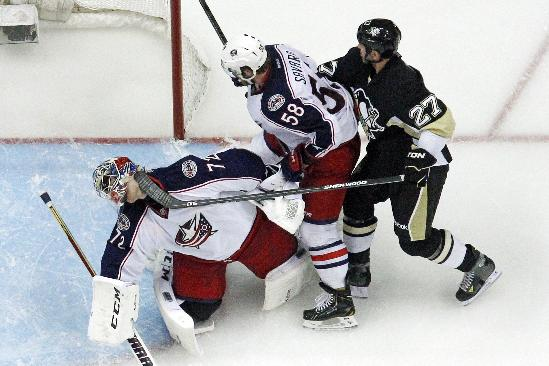 Pittsburgh Penguins' Craig Adams (27) gets his stick up under the mask of Columbus Blue Jackets goalie Sergei Bobrovsky (72) in the third period of a first-round NHL playoff hockey game in Pittsburgh Saturday, April 19, 2014. Adams was penalized two-minutes for high-sticking. The Blue Jackets won in double overtime, 4-3