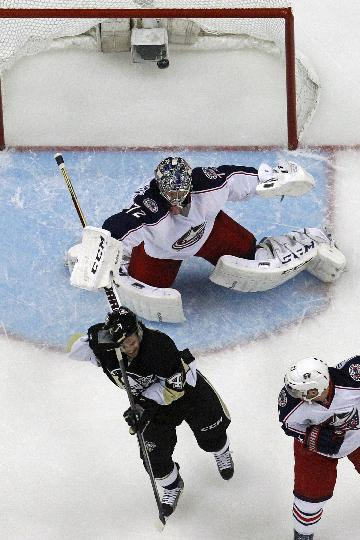Pittsburgh Penguins' Brian Gibbons (49) deflects a shot over Columbus Blue Jackets goalie Sergei Bobrovsky (72) for a goal in the first period of a first-round NHL playoff hockey game in Pittsburgh Saturday, April 19, 2014. The Blue Jackets won in double overtime, 4-3 to even the series at 1-1