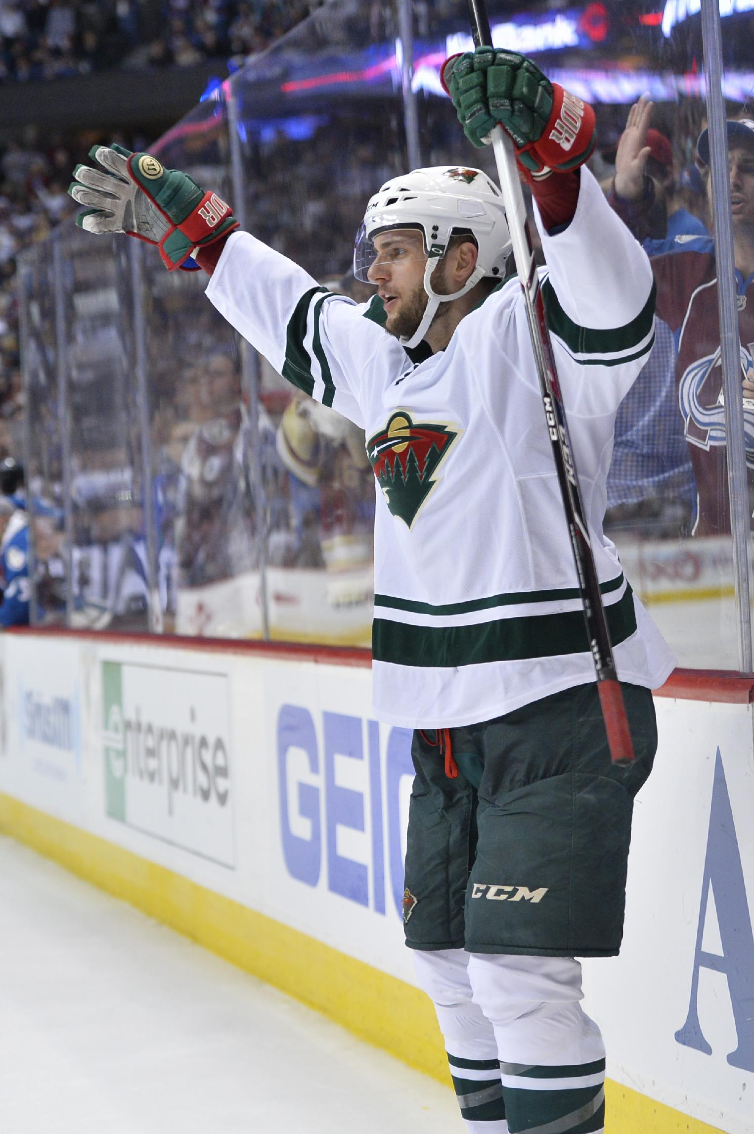 Minnesota Wild defenseman Marco Scandella (6) celebrates a goal against the Colorado Avalanche in the third period of Game 2 of an NHL hockey first-round playoff series on Saturday, April 19, 2014, in Denver. The Avalanche beat the Wild 4-2