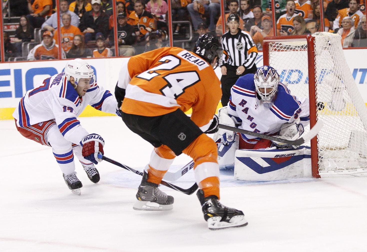 Philadelphia Flyers' Matt Read, center, shoots the puck past New York Rangers' Henrik Lundqvist, right, of Sweden, for a goal as John Moore tries to defend during the first period in Game 4 of an NHL hockey first-round playoff series on Friday, April 25, 2014, in Philadelphia
