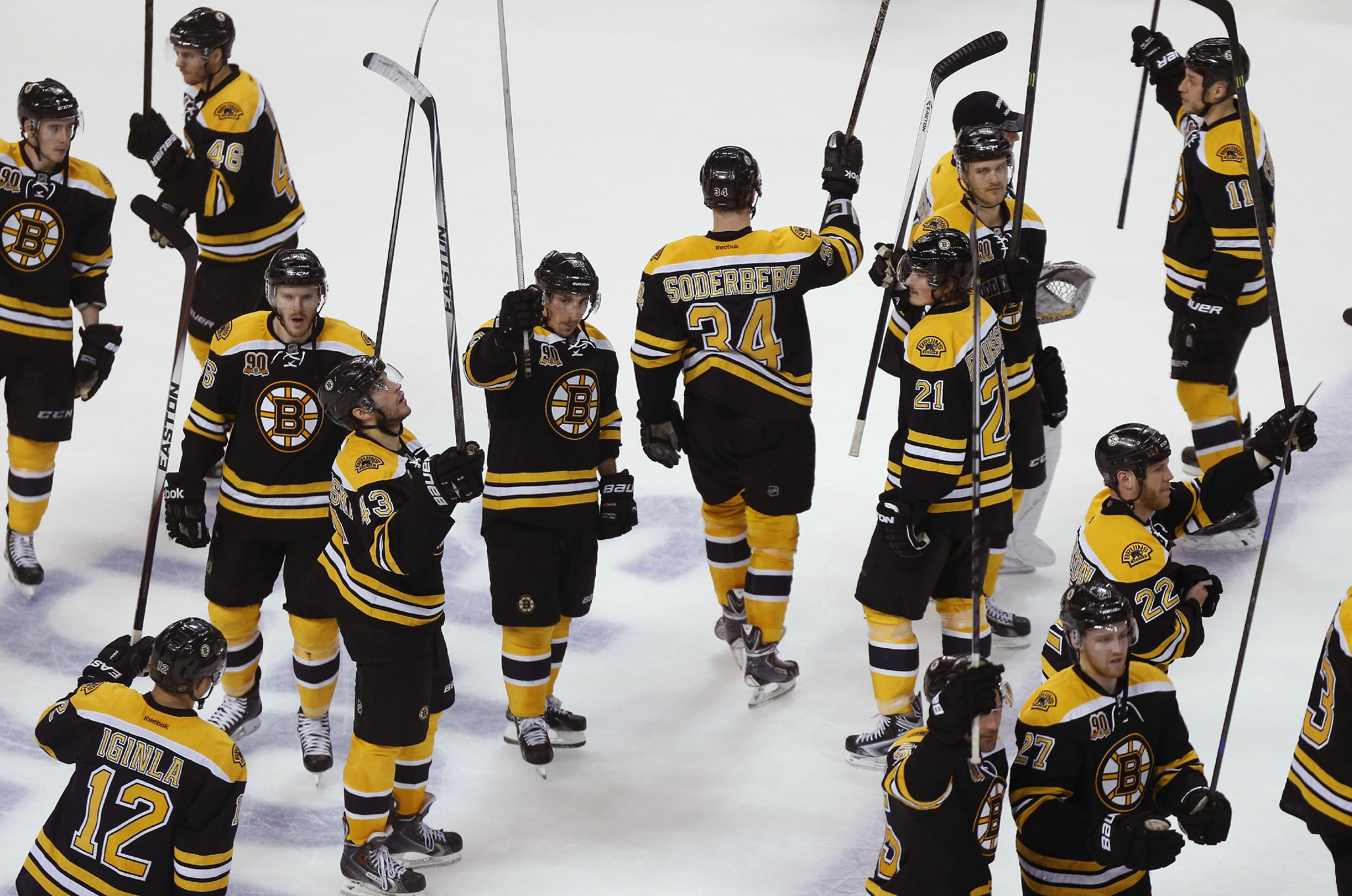 The Boston Bruins celebrate their 4-2 win against the Detroit Red Wings in Game 5 in the first round of the NHL hockey Stanley Cup playoffs  in Boston, Saturday, April 26, 2014. The win eliminated the Red Wings from the postseason