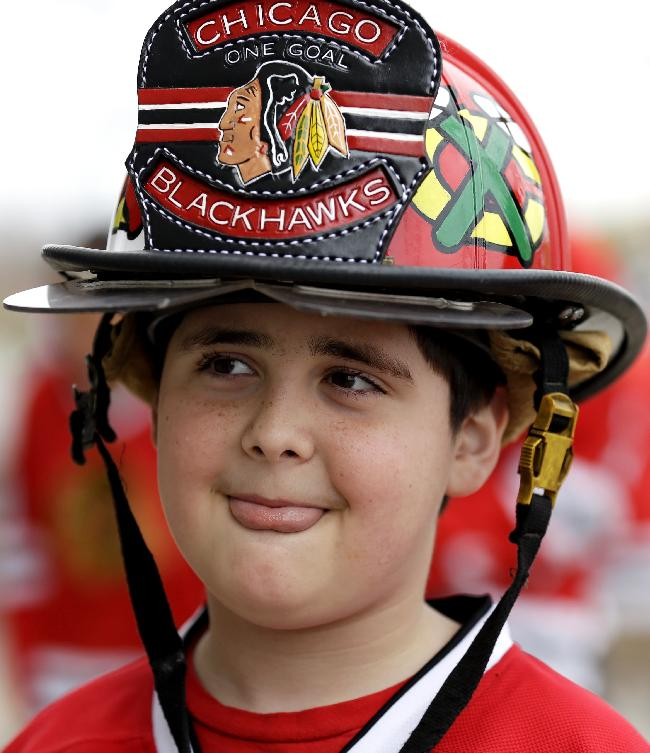 George Yakowenko, 9, waits outside of arena for Game 2 of an NHL hockey second-round playoff series between the Minnesota Wild and the Chicago Blackhawks in Chicago, Saturday, May 4, 2014