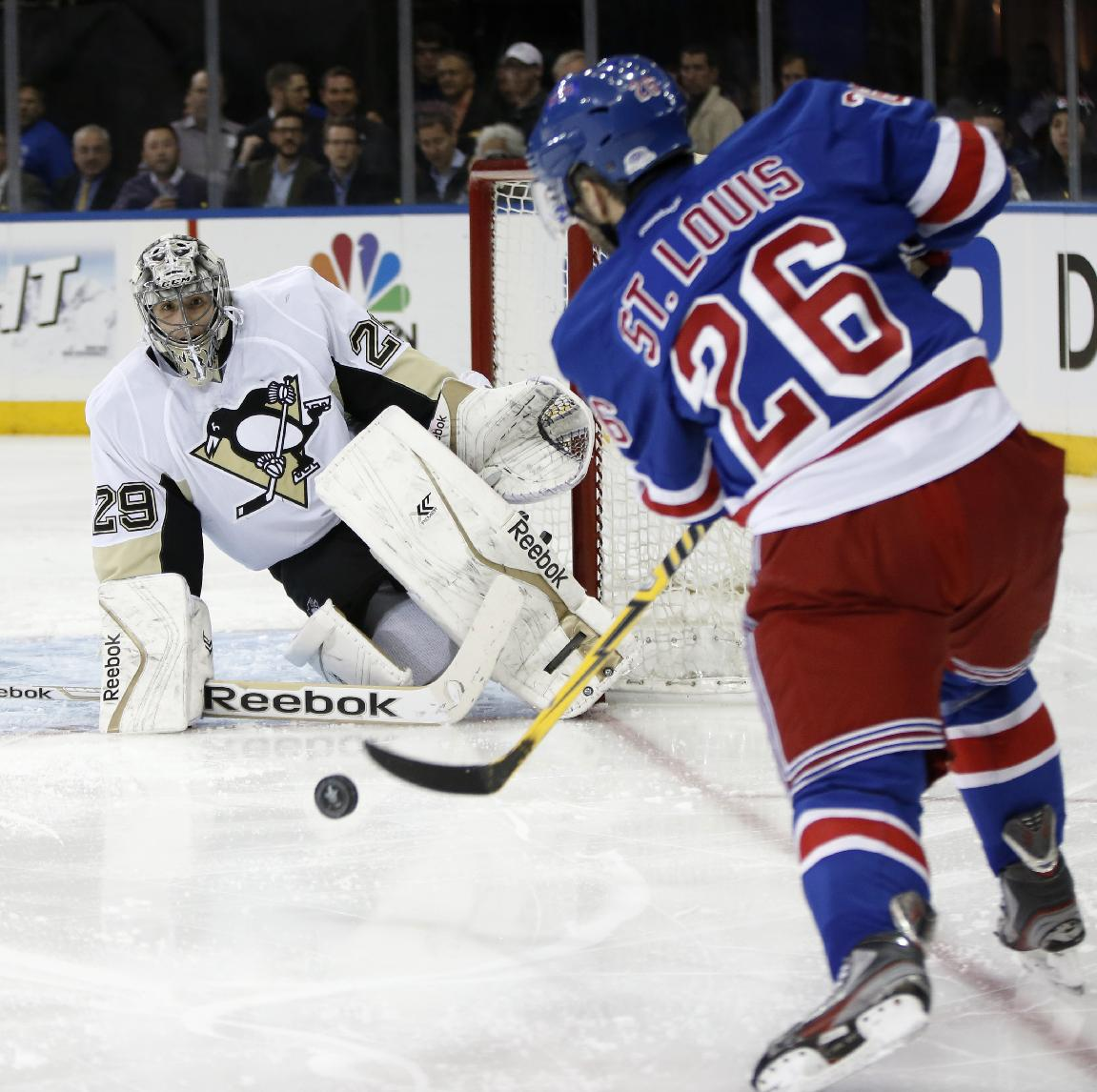 New York Rangers right wing Martin St. Louis (26) takes a shot on Pittsburgh Penguins goalie Marc-Andre Fleury (29) in the second period of their second-round NHL Stanley Cup hockey playoff game at Madison Square Garden in New York, Monday, May 5, 2014