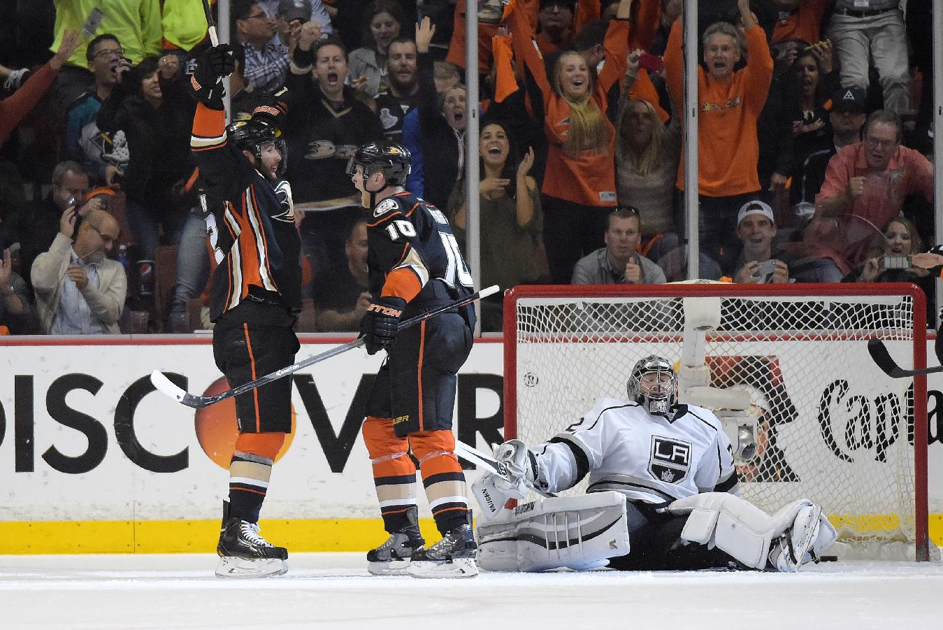 Anaheim Ducks left wing Patrick Maroon, left, celebrates his goal with teammate Corey Perry, center, as Los Angeles Kings goalie Jonathan Quick, right, looks on during the first period in Game 2 of an NHL hockey second-round Stanley Cup playoff series, Monday, May 5, 2014, in Anaheim, Calif