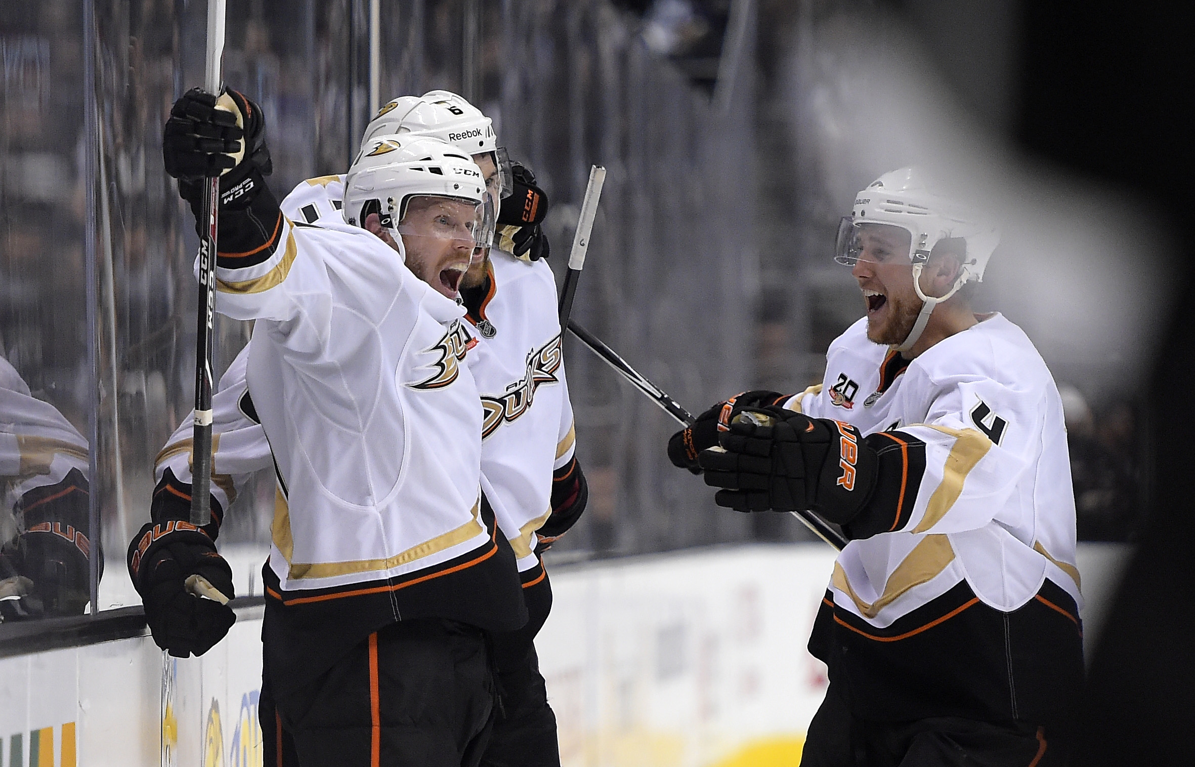 Anaheim Ducks Saku Koivu, left, of Finland, celebrates the goal of defenseman Ben Lovejoy, center, with defenseman Cam Fowler during the third period in Game 3 of an NHL hockey second-round Stanley Cup playoff series against the Los Angeles Kings, Thursday, May 8, 2014, in Los Angeles. The Ducks won 3-2