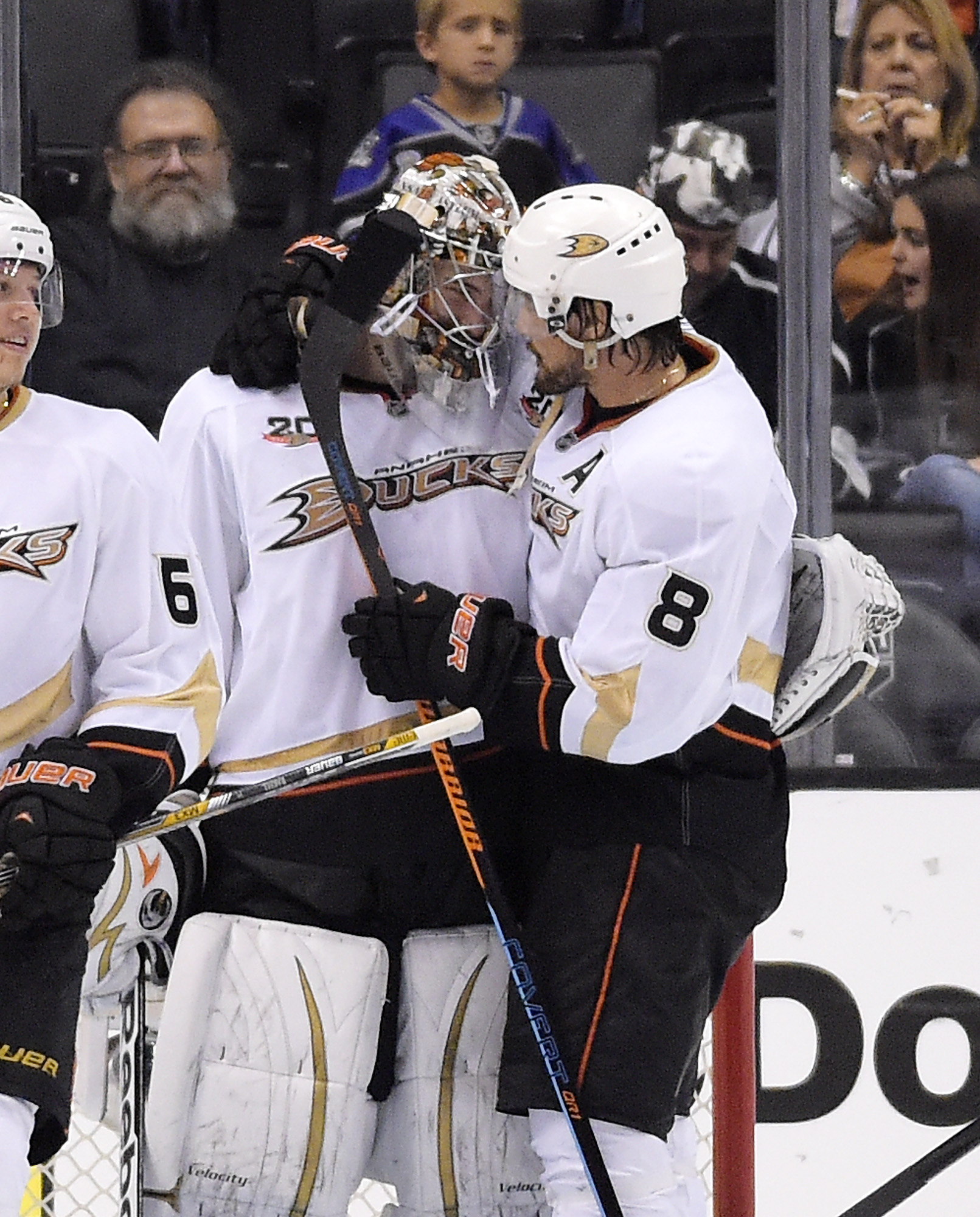 Anaheim Ducks right wing Teemu Selanne, of Finland, congratulates Anaheim Ducks goalie John Gibson after Game 4 of an NHL hockey second-round Stanley Cup playoff series, Saturday, May 10, 2014, in Los Angeles. The Duck won 2-0