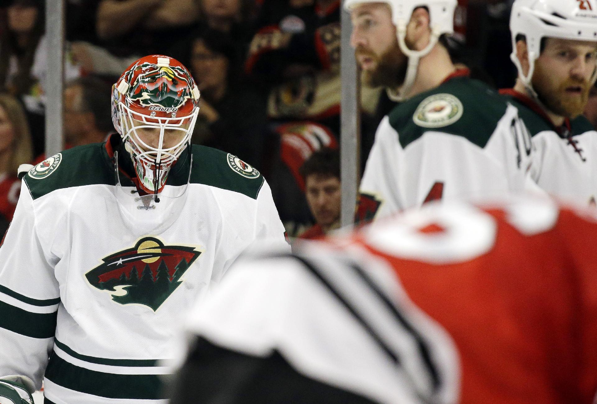 Minnesota Wild goalie Ilya Bryzgalov, left, looks down during the second period in Game 5 of an NHL hockey second-round playoff series against the Chicago Blackhawks in Chicago, Sunday, May 11, 2014. The Blackhawks won 2-1