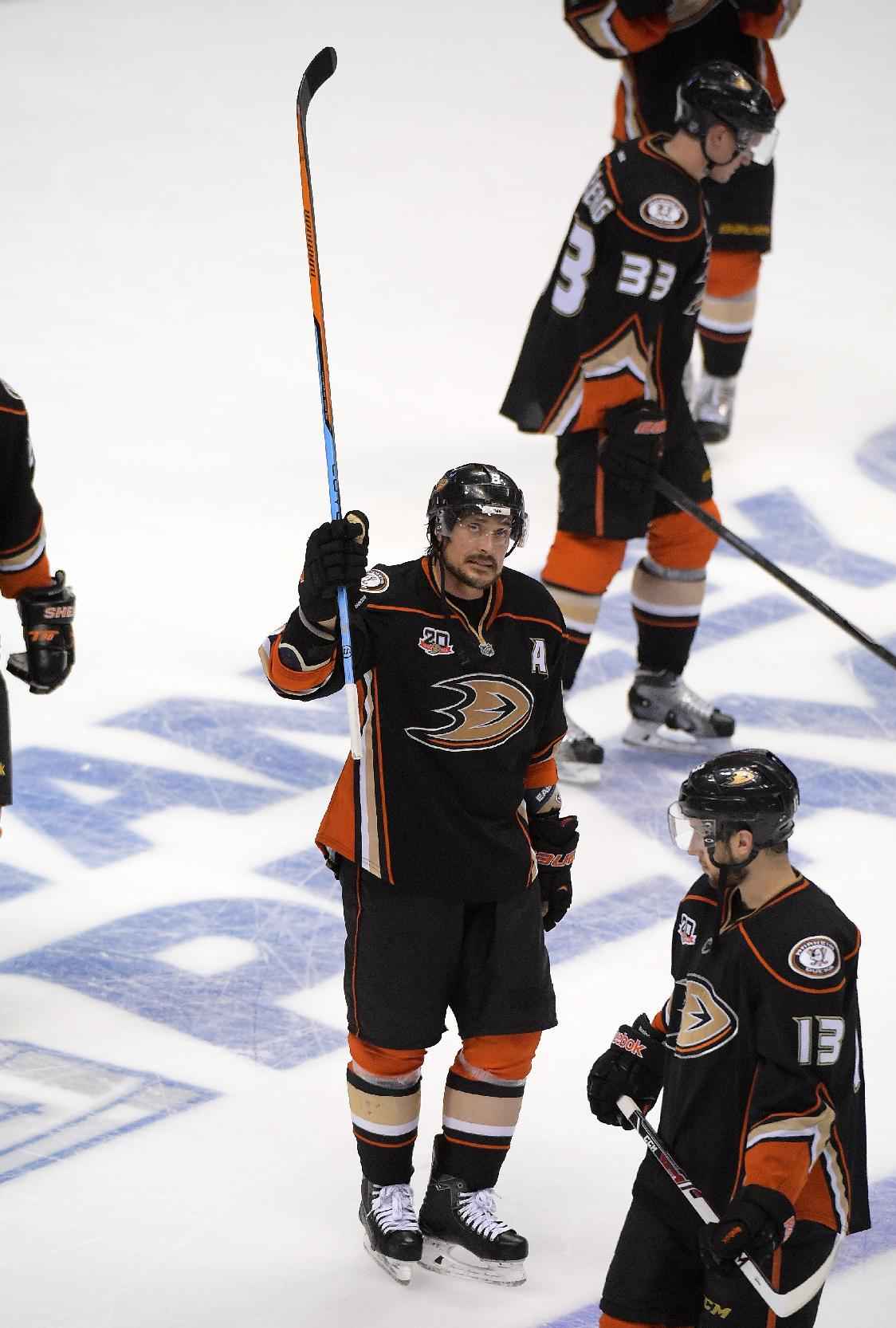 Anaheim Ducks right wing Teemu Selanne, left, of Finland, acknowledges the crowd as left wing Jakob Silfverberg, top, and center Nick Bonino look on after they were defeated by ;the Los Angeles Kings in Game 7 of an NHL hockey second-round Stanley Cup playoff series, Friday, May 16, 2014, in Anaheim, Calif. The Kings won 6-2