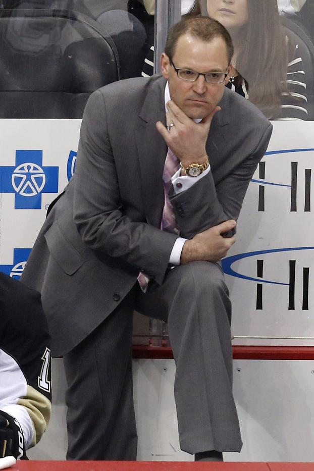 In this Jan. 20, 2014 file photo, Pittsburgh Penguins head coach Dan Bylsma stands behind his bench during an NHL hockey game against the Florida Panthers in Pittsburgh. Former Penguins coach Bylsma is set to work for the NHL Network as a studio analyst. The network plans to include the coach fired by Pittsburgh on Friday when it broadcasts live from outside Madison Square Garden before Game 3 of the Stanley Cup finals