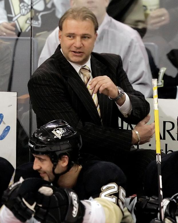 Pittsburgh Penguins coach Michel Therrien works behind the bench against the New York Rangers in NHL hockey action at Pittsburgh Monday, Jan. 14, 2008. The Penguins won 4-1
