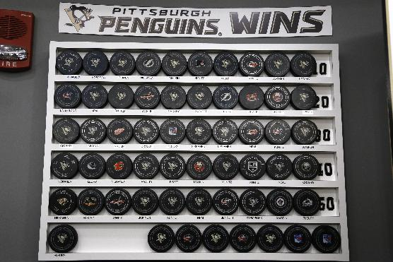 This is a display of pucks, each one signifying a Penguins win this season, in the Pittsburgh Penguins locker room at the Consol Energy Center in Pittsburgh, Thursday, May 15, 2014