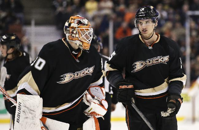 In this Feb. 28, 2013, file photo, Anaheim Ducks goalie Viktor Fasth, left, talks with defenseman Luca Sbisa during an NHL hockey game against the Nashville Predators in Anaheim, Calif. The Anaheim Ducks have acquired center Ryan Kesler from the Vancouver Canucks in a trade for center Nick Bonino, defenseman Luca Sbisa, seen, and the 24th overall pick in Friday's, june 27, 2014, draft