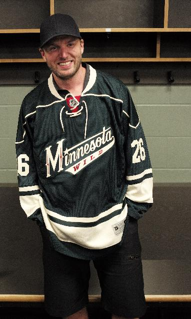 Thomas Vanek poses after he signed a three-year deal to play with the Minnesota Wild, Tuesday, July 1, 2014 in St. Paul, Minn