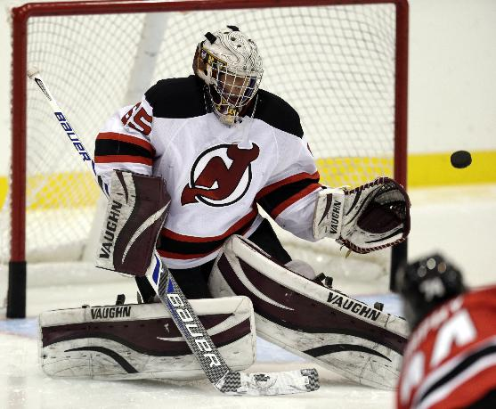 Jeremy Brodeur, son of New Jersey Devils goalkeeper Martin Brodeur, deflects a shot by Darcy Murphy during the Devils' rookies NHL hockey camp,, Tuesday, July 15, 2014, in Newark, N.J