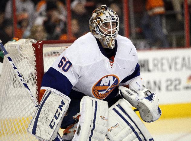 New York Islanders' Kevin Poulin in an NHL hockey game with the Philadelphia Flyers, Saturday, Jan. 18,  2014, in Philadelphia