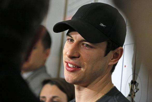 Pittsburgh Penguins captain Sidney Crosby answers a reporter's question in the Penguins' locker room during locker clean out day at the Consol Energy Center in Pittsburgh, Thursday, May 15, 2014