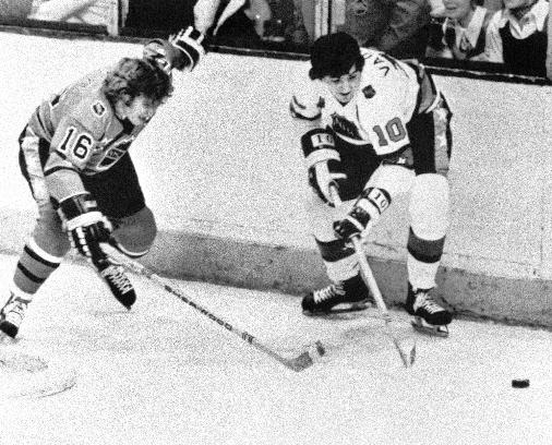 In this Jan. 22, 1975, file photo, Carol Vadnais (10) of the Prince of Wales division, battles for possession with Bobby Clarke (16) of the Clarence Campbell division during the annual All-Star contest in Montreal. Vadnais, a six-time all-star, has died. He was 68. The New York Rangers reported on their website that Vadnais, who spent seven seasons with the team, passed away Sunday. A cause of death was not given