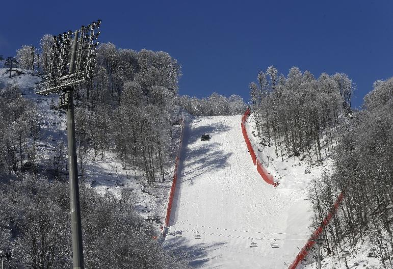 A view from the finish area up the alpine ski course of the Sochi 2014 Winter Olympics, Saturday, Feb. 1, 2014, in Krasnaya Polyana, Russia