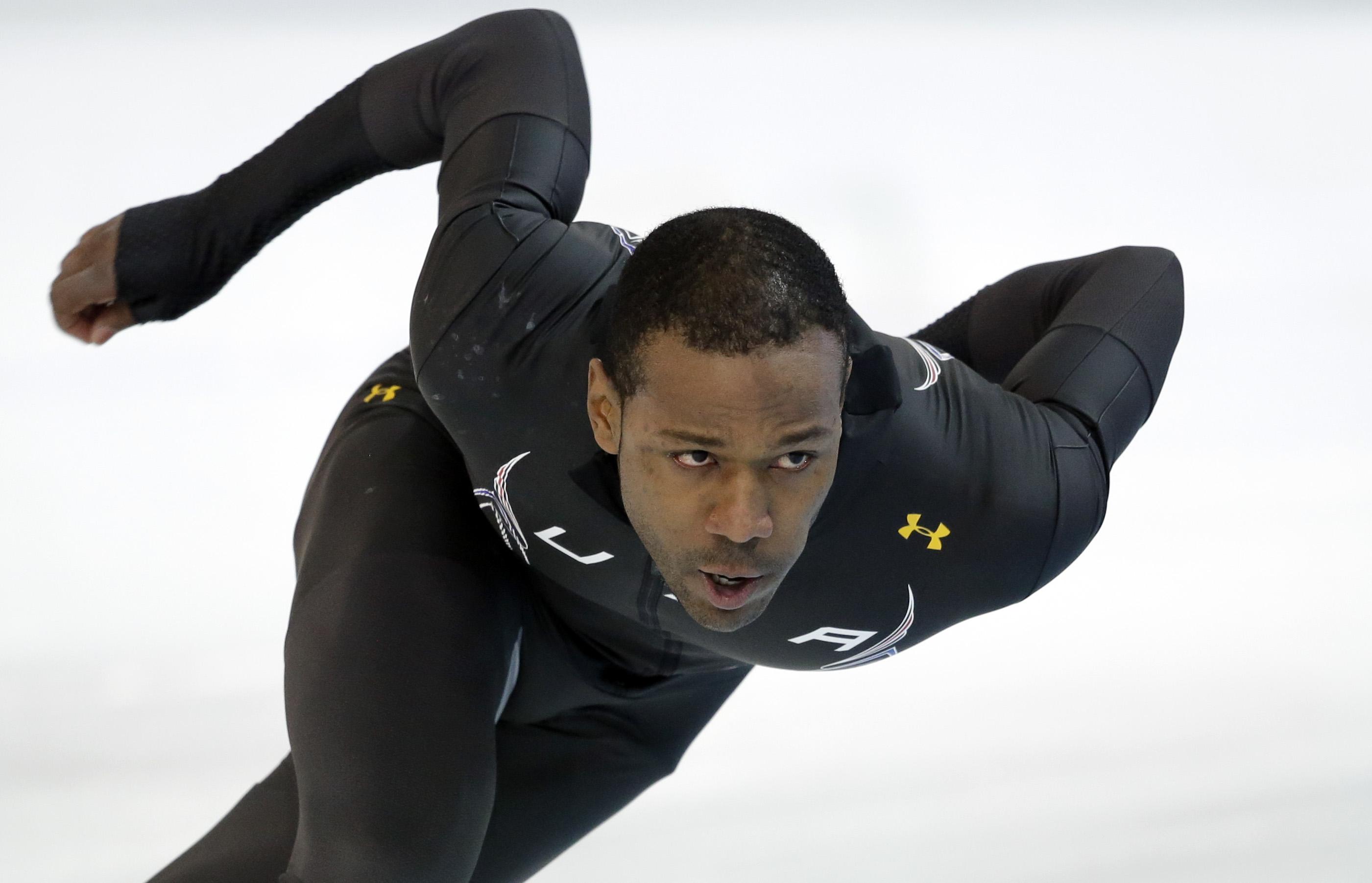 Speedskater Shani Davis of the U.S. trains at the Adler Arena Skating Center during the 2014 Winter Olympics in Sochi, Russia, Thursday, Feb. 6, 2014