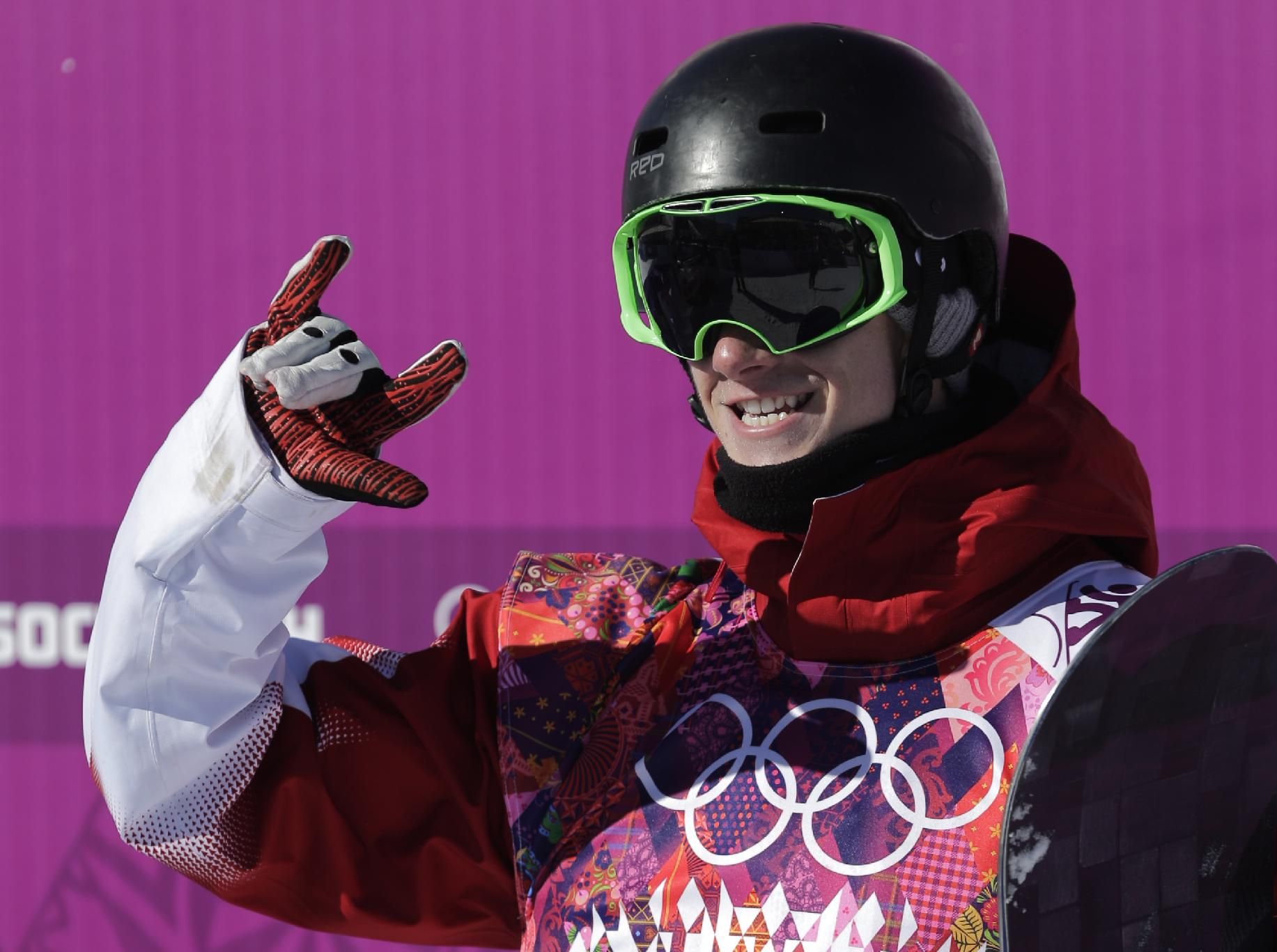 Canada's Maxence Parrot reacts after a run during the men's snowboard slopestyle qualifying at the Rosa Khutor Extreme Park ahead of the 2014 Winter Olympics, Thursday, Feb. 6, 2014, in Krasnaya Polyana, Russia