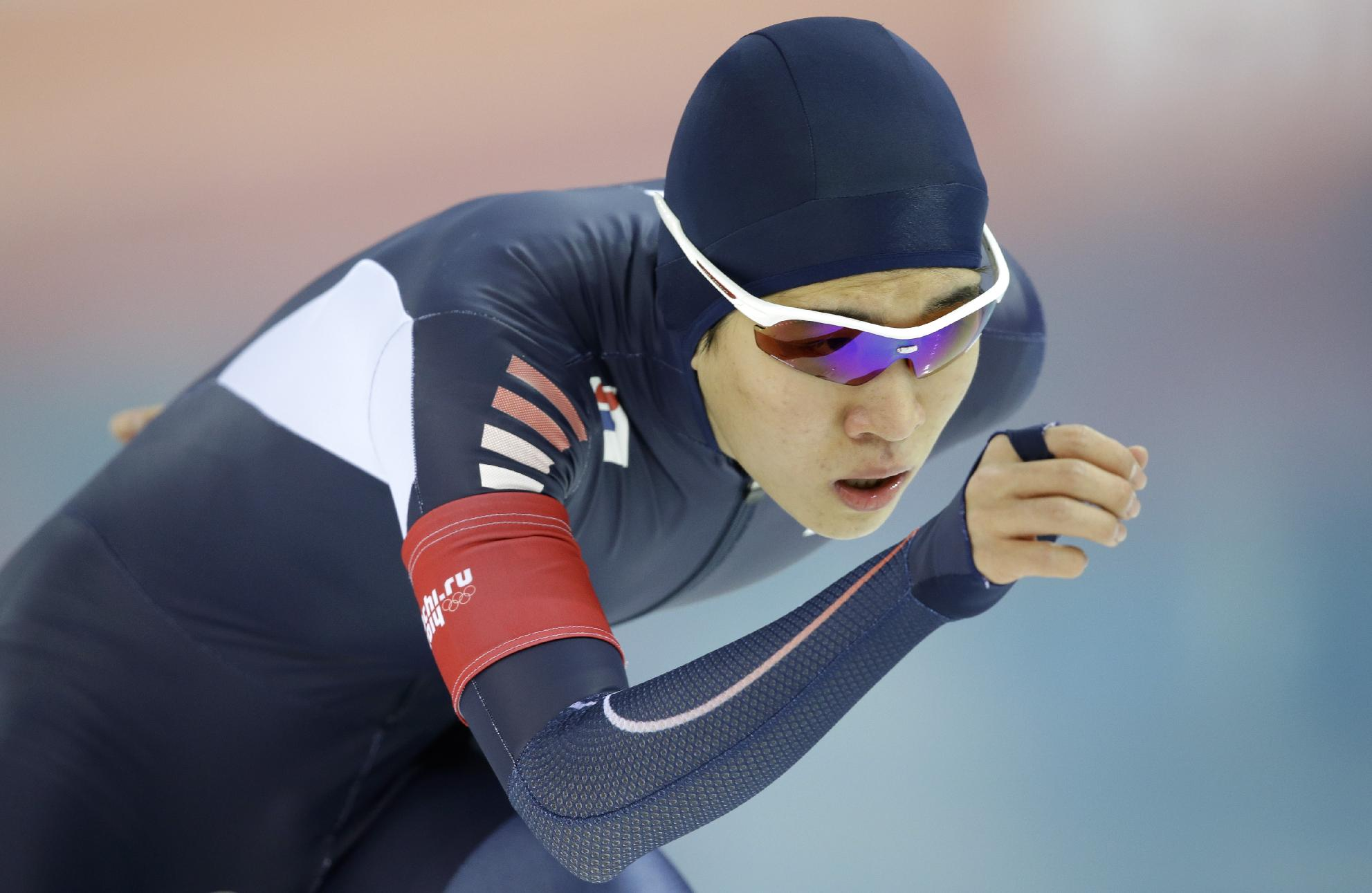 South Korean speedskater Kim Cheol-min competes in the men's 5,000-meter speedskating race at the Adler Arena Skating Center during the 2014 Winter Olympics, Saturday, Feb. 8, 2014, in Sochi, Russia