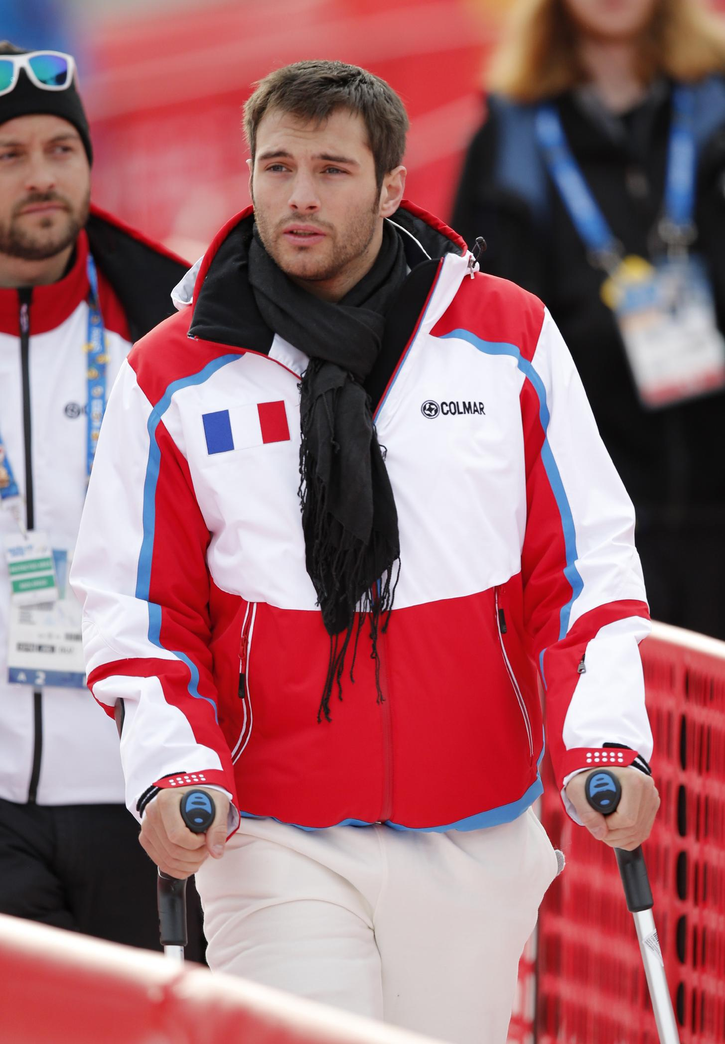Brice Roger of France, who was injured during training, arrives in the finish area of the Alpine ski venue before the men's downhill at the Sochi 2014 Winter Olympics, Sunday, Feb. 9, 2014, in Krasnaya Polyana, Russia