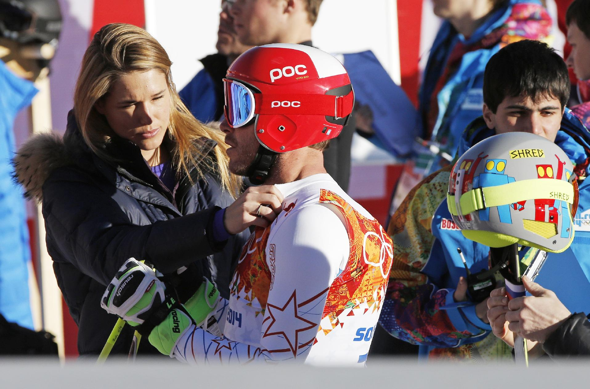 United States' Bode Miller has his ski bib adjusted by his wife Morgan Miller after completing men's downhill combined training at the Sochi 2014 Winter Olympics, Thursday, Feb. 13, 2014, in Krasnaya Polyana, Russia