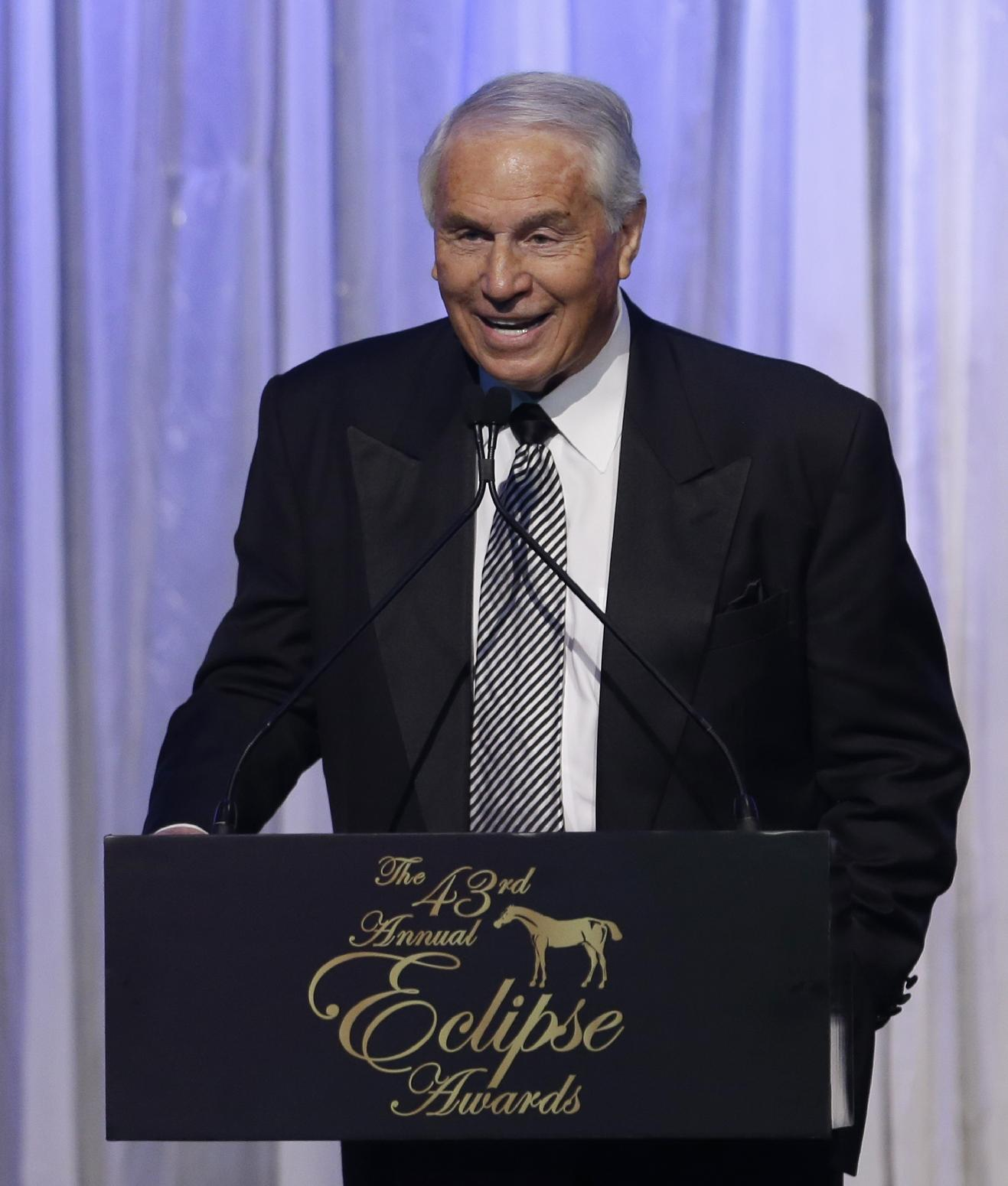 D. Wayne Lukas  smiles as he talks to guests after receiving the Eclipse Award of Merit, the game's lifetime achievement award, at the Eclipse Awards at Gulfstream Park in Hallandale Beach, Fla., Saturday, Jan. 18, 2014. (AP PhotoAlan Diaz)