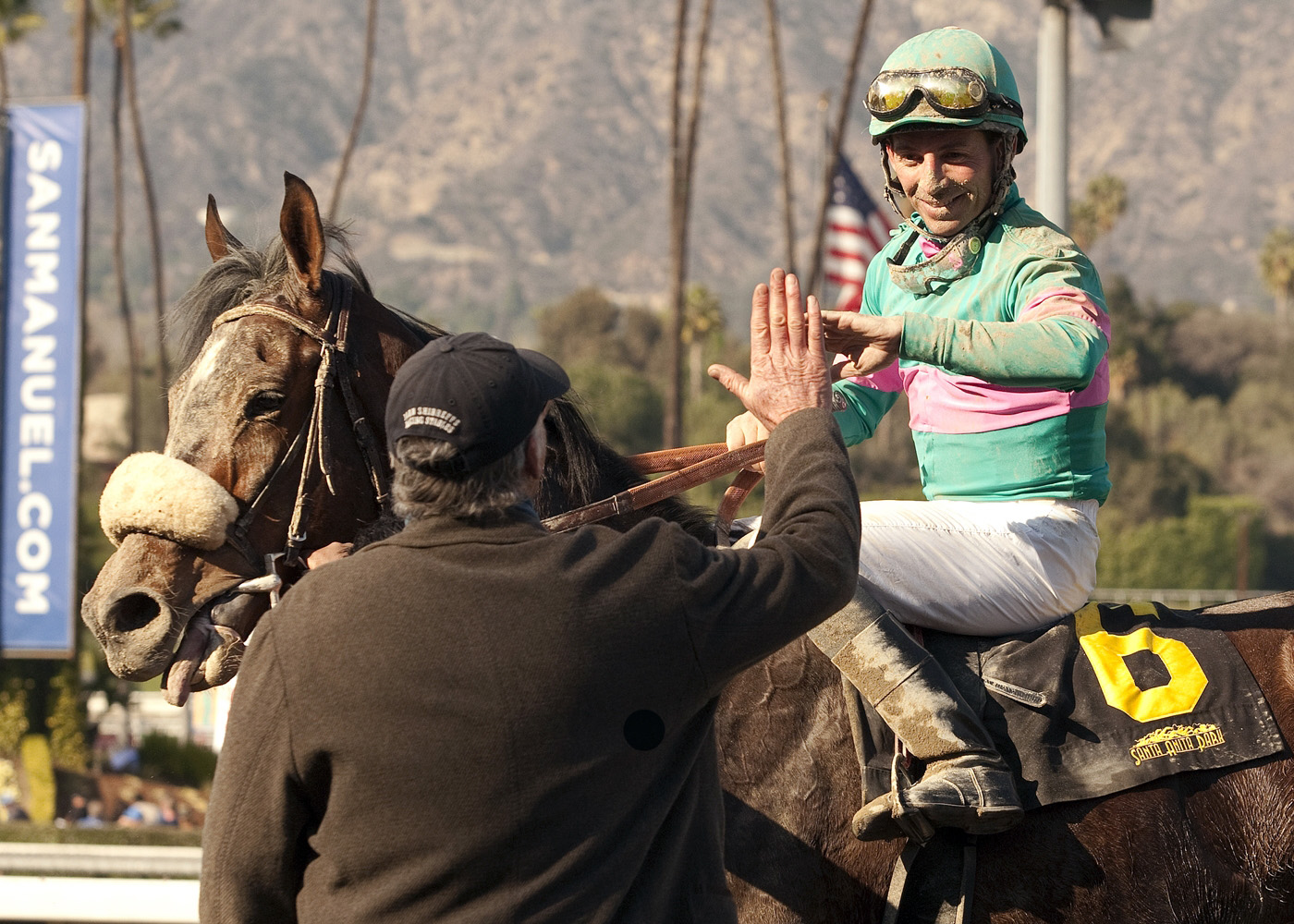 In this image provided by Benoit Photo, trainer John Shirreffs, left, congratulates jockey Aaron Gryder after Blingo's win in the Grade II San Antonio Stakes horse race on Saturday, Feb. 8, 2014, at Santa Anita Park in Arcadia, Calif