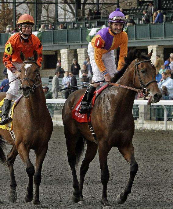 Robby Albarado, right, aboard Medal Count, smiles as he heads to the winner's circle after coming from behind to capture the Transylvania Stakes horse race on opening day at Keeneland in Lexington, Ky., Friday, April 4, 2014. Corey Lanerie, left, aboard Hesinfront, finished sixth