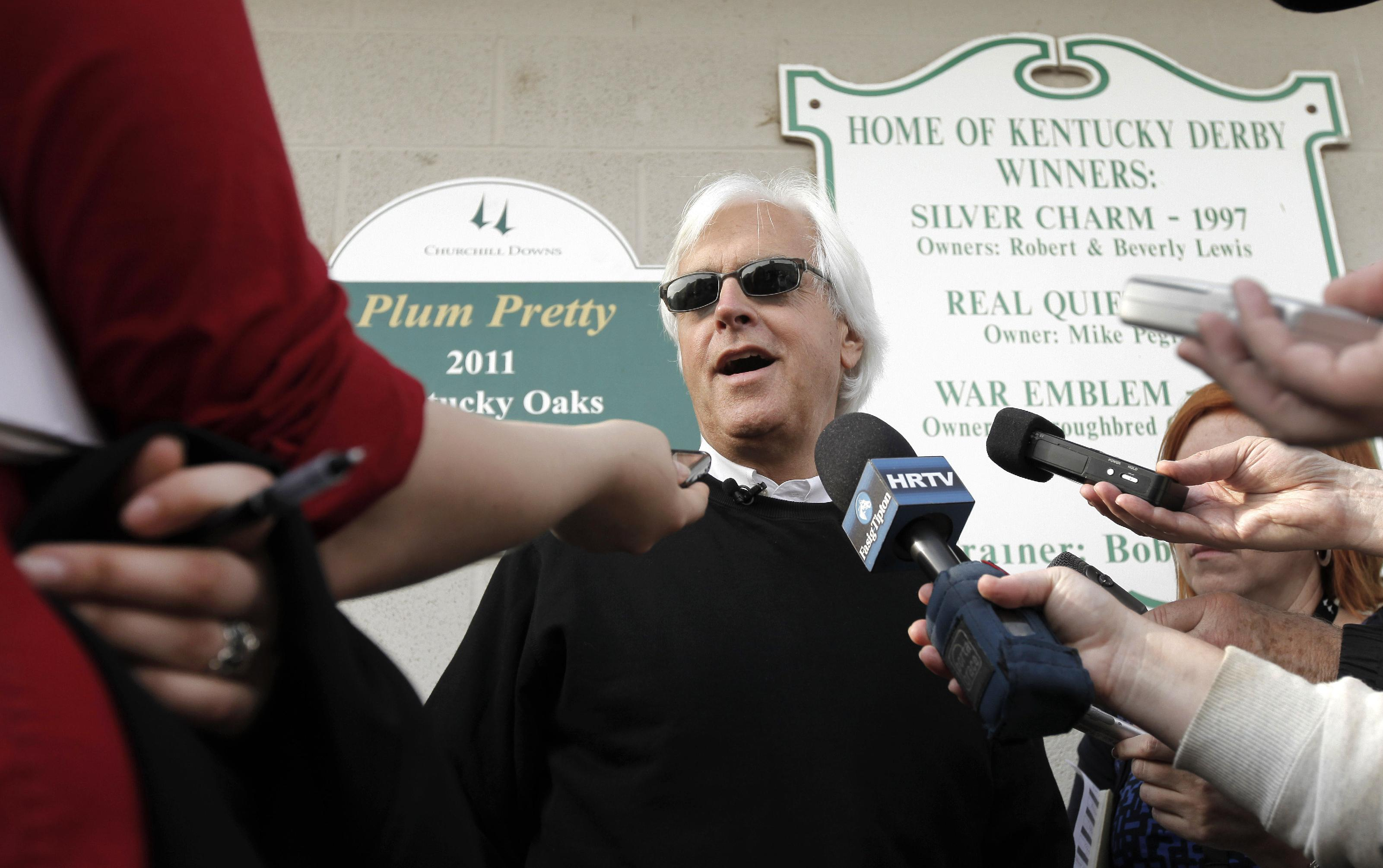 In this April 30, 2012 file photo, trainer Bob Baffert talks to the media after Kentucky Derby hopeful Liaison worked out at Churchill Downs in Louisville, Ky. Baffert, a three-time Derby winner, will saddle three horses in the 140th Kentucky Derby on May 3, 2014