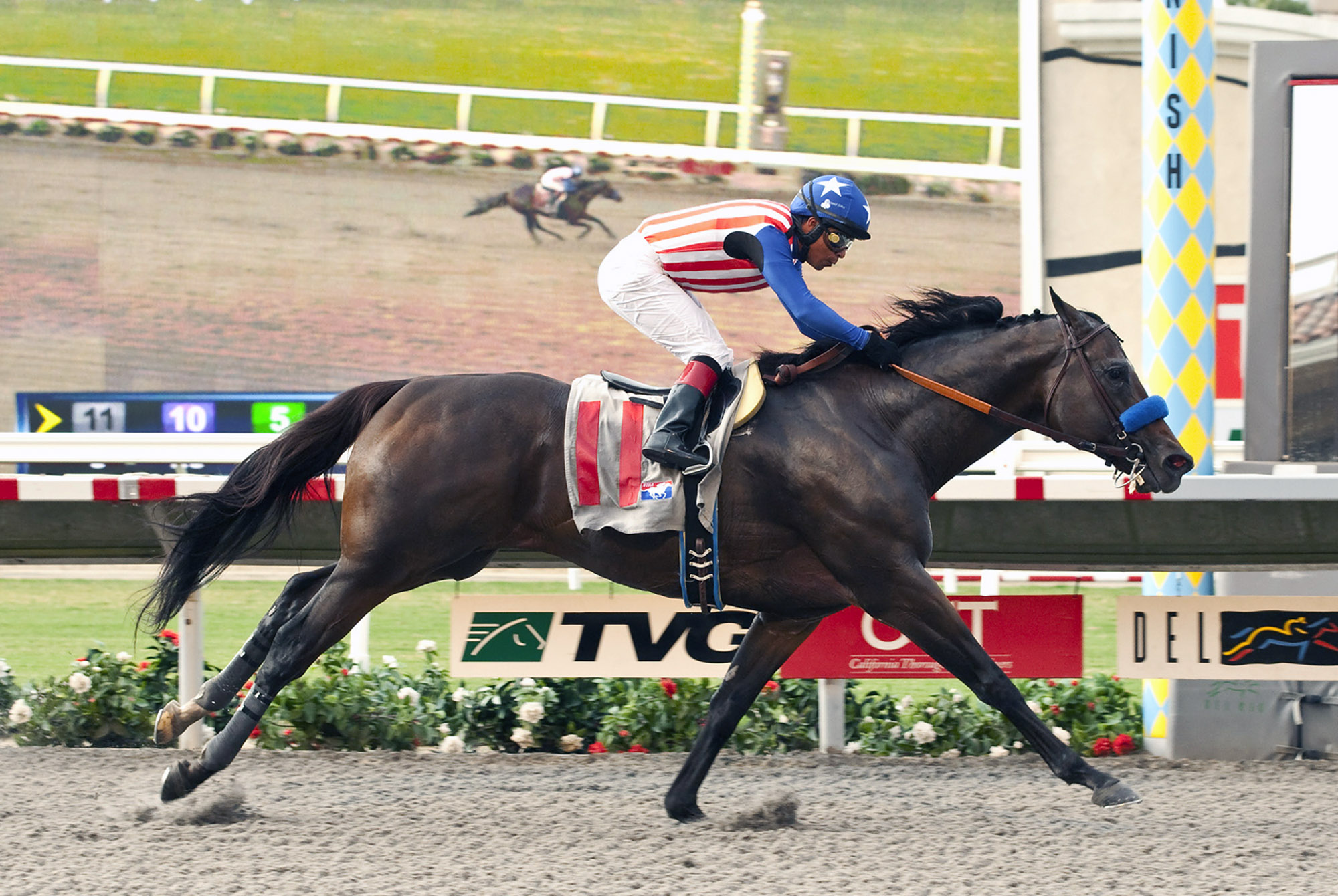 In this image provided by Benoit Photo, Fed Biz, with Martin Garcia aboard, wins the Grade II, $200,000 San Diego Handicap horse race on Saturday, July 26, 2014, at Del Mar Thoroughbred Club in Del Mar, Calif