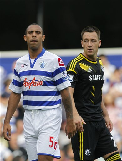 Queens Park Rangers' Anton Ferdinand, left, is marked by Chelsea's John Terry. (AP)