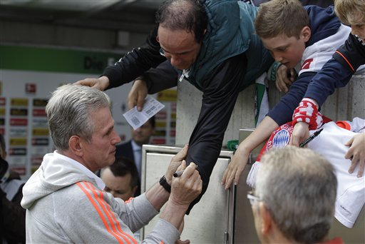 Bayern head coach Jupp Heynckes signs autograph prior to his last German first division Bundesliga soccer match between VfL Borussia Moenchengladbach  and Bayern Munich in Moenchengladbach, Germany, Saturday, May 18, 2013. Heynckes started his career in Moenchengladbach