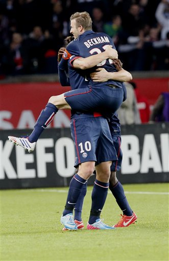 Paris Saint Germain's  David Beckham celebrates with his teammate Zlatan Ibrahimovic after he scored in his French League One soccer match against  Brest, at Parc des Princes  Stadium, in Paris, Saturday, May 18, 2013. Paris Saint-Germain hopes to strike a deal with David Beckham in the next two weeks in which the former England captain will work with the French club after retirement, possibly in an ambassadorial role