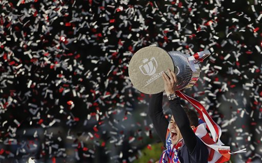 Atletico de Madrid's Gabi Fernandez holds the trophy in Neptuno Square in Madrid, Spain, Saturday, May 18, 2013. Atletico de Madrid defeated Real Madrid in the Copa del Rey final soccer match on Friday