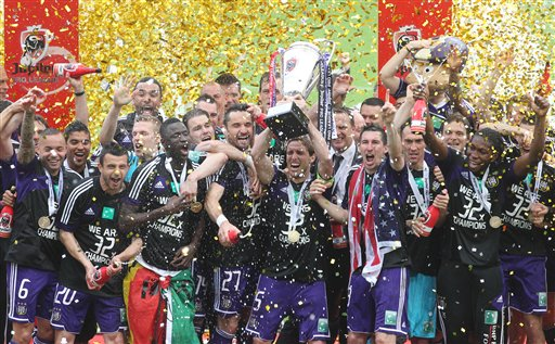 RSC Anderlecht players celebrate on the podium after defeating SV Zulte Waregem and winning the final soccer match of the Belgian League at the Constant Vanden Stock stadium in Brussels, Sunday, May 19, 2013