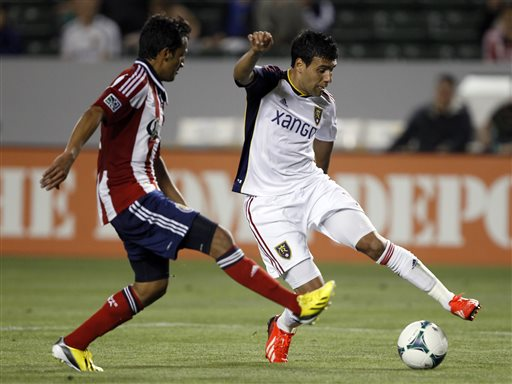 Real Salt Lake midfielder Javier Morales, right, stops the ball with Chivas USA midfielder Martin Ponce defending during the second half of an MLS soccer game in Carson, Calif., Sunday, May 19, 2013. Real Salt Lake won the match 4-1