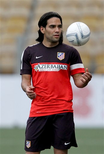 Atletico Madrid's Radamel Falcao plays with a soccer ball during a mass soccer game with 130 school students in Singapore on Tuesday, May 21, 2013. Atletico Madrid will not stand in the way of striker Falcao if he wants to leave the club this offseason, general manager Miguel Angel Gil Marin said Monday. The 27-year-old striker has been linked with possible moves to Manchester City, Manchester United, Chelsea, French side Monaco and Real Madrid