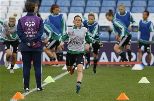 Wolfsburg's captain Nadine Kessler, centre, trains with her team during a training session at Stamford Bridge Stadium in London Wednesday, May 22, 2013.   Wolfsburg will play Olympique Lyonnais in the Women's Champions League final soccer match at the stadium on Thursday May 23