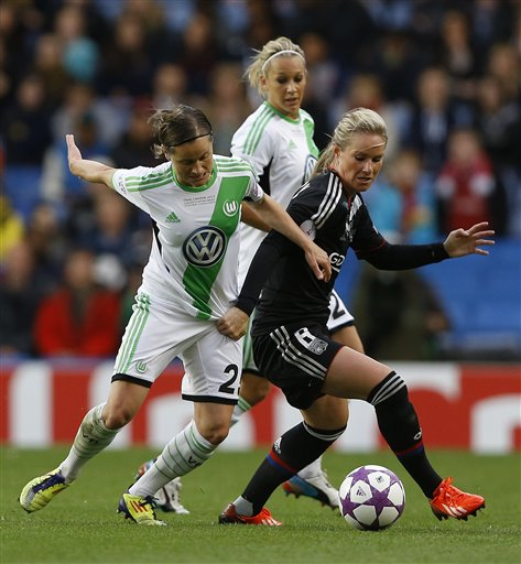 Wolfsburg's Martina Mueller, left, vies for the ball; with Lyon's Amandine Henry during the Women's Champions League final soccer match between Wolfsburg and Olympique Lyonnais at Stamford Bridge Stadium in London Thursday, May 23, 2013