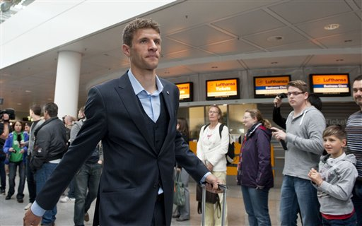 Munichs  soccer player  Thomas Mueller  on his way to board a plane to London at the  airport  in Munich, Germany Friday May 24, 2013. Bayern  Munich will play against  German rival Borussia Dortmund in a UEFA Champions League final on Saturday in London